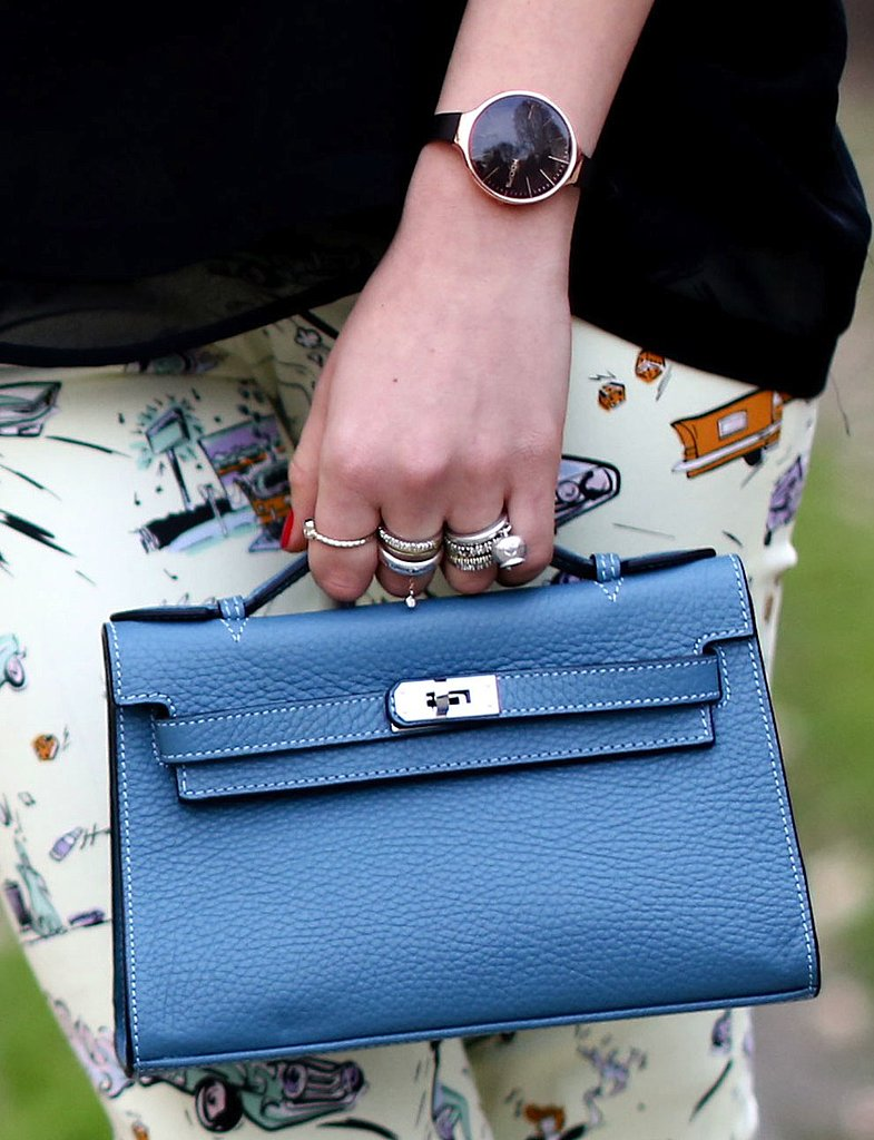 A mini blue Kelly bag added a feminine finish to fun printed jeans.