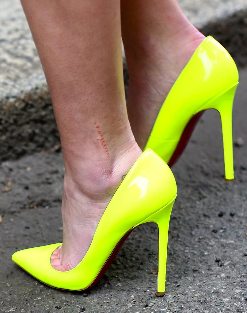 This Fashion Week attendee bared her legs (and feet) in a pair of eye-catching neon yellow heels.