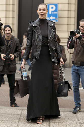 Karlie Kloss looked biker-chic in a black maxi, turtleneck, and cool-girl leather jacket.
