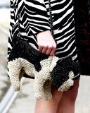 This style setter's love for animal prints was not only apparent on her coat, but also in the form of this adorable puppy bag.