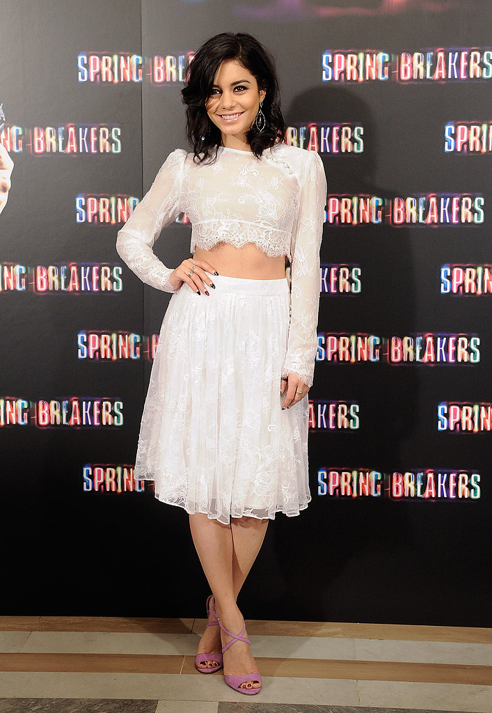 Vanessa Hudgens looked simultaneously sweet and sexy in a white lace crop top and a matching skirt, by Katharine Kidd. Her lilac strappy Jerome C. Rousseau sandals added a girlie touch.
