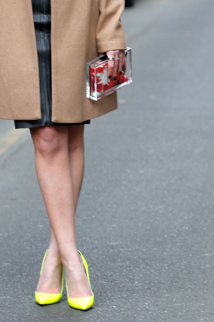 Neon yellow pumps and a clear box clutch added a whimsical element to Winter neutrals.