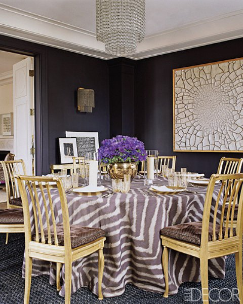 Purple shades, gold furnishings, and a glamorous chandelier give Aerin's Manhattan dining room a refined look. Source: Elle Decor