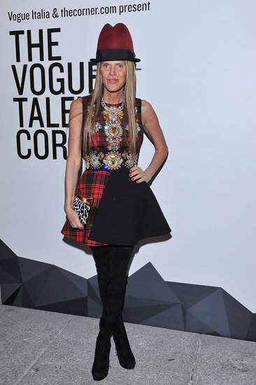 Anna Dello Russo topped her plaid and embroidered dress with her signature accessory, a dramatic hat, at the Vogue Talents event in Milan.