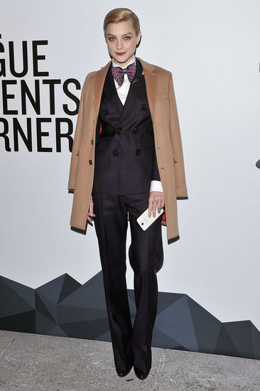 Jessica Stam looked dapper in a double-breasted pantsuit, printed bow tie, and camel coat during the Vogue Talents party at Milan Fashion Week.