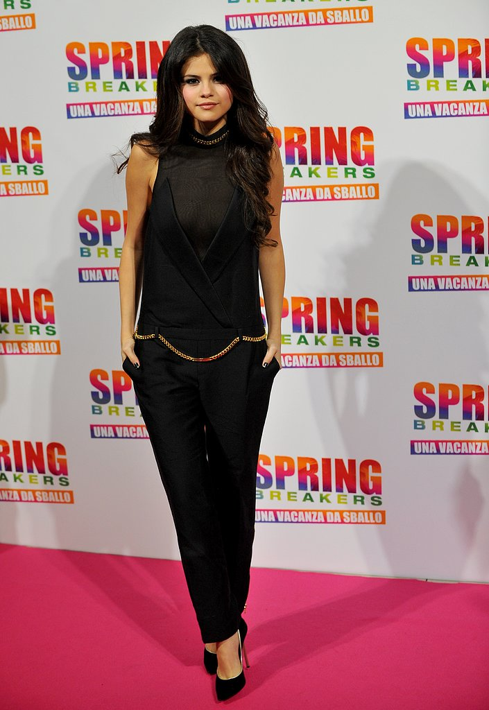 For the Rome photocall for Spring Breakers, Selena Gomez chose a black Thomas Wylde jumpsuit with gold chain detailing and Casadei pumps.