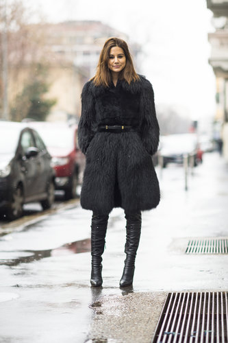 Christine Centenera bundled up in the most luxurious of jackets, then stepped into a pair of thigh-high leather boots. Source: Le 21ème | Adam Katz Sinding