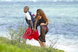 Chris Brown and Rihanna held hands as they took a walk along a Hawaiian beach on Rihanna's birthday on February 20.