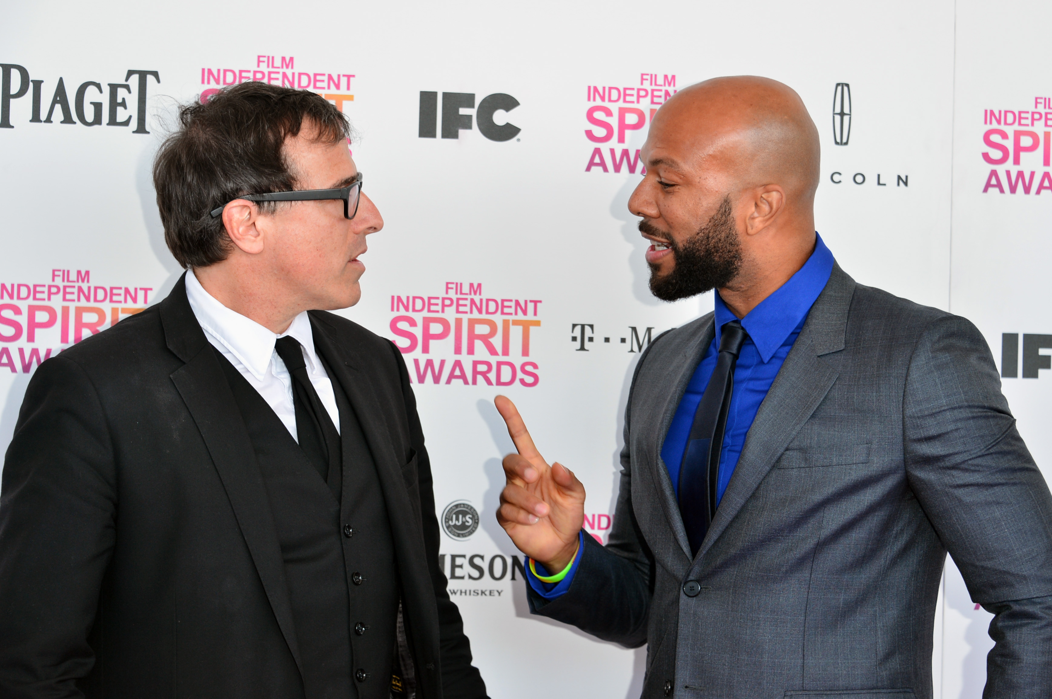 David O. Russell and Common on the red carpet at the Spirit A