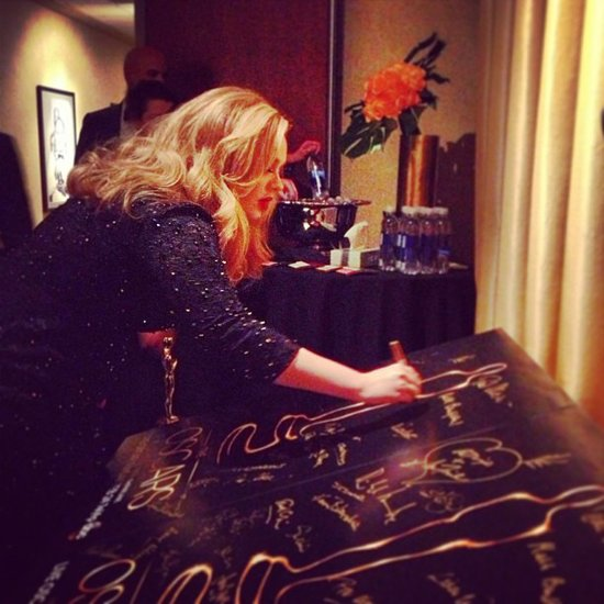 "Adele stepped up to sign the winners poster after being awarded best song for ""Skyfall.""  Source: Instagram user theacademy"