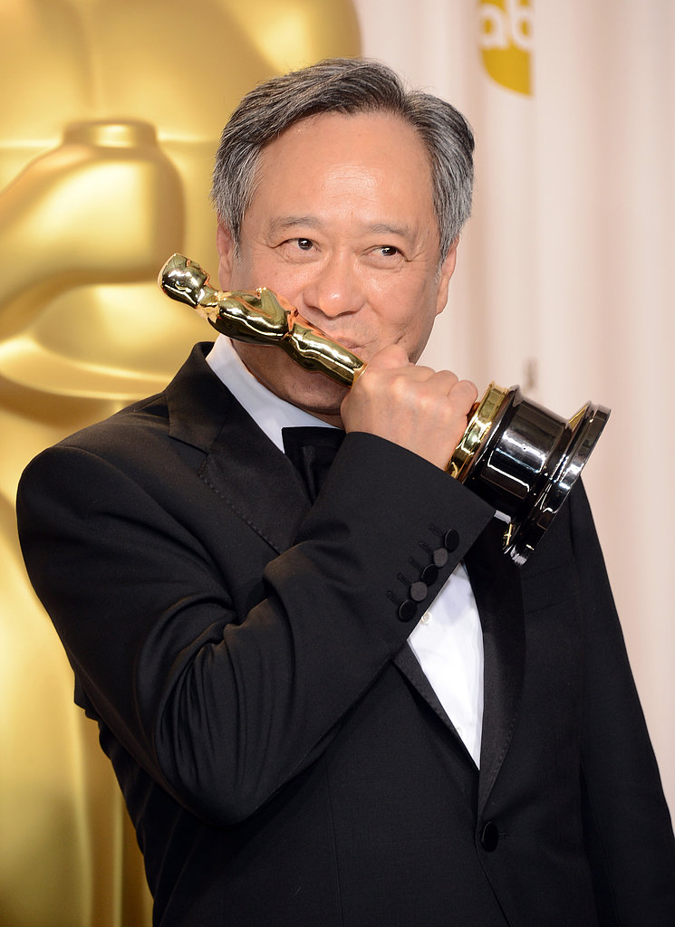 Ang Lee kissed his Oscar for best director in Life of Pi.