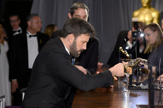 Ben Affleck studied his Oscar at the Governors Ball.