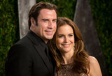 John Travolta smiled with Kelly Preston.