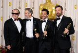 George Clooney, Grant Heslov, and Ben Affleck posed for press room pictures with Jack Nicholson, who presented them with their Argo best picture trophies.