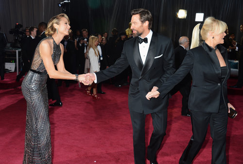Stacy Keibler shook Hugh Jackman's hand as he passed by on the red carpet.