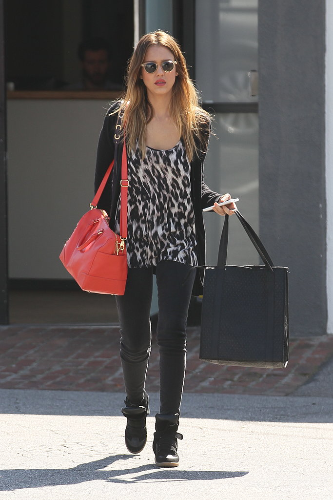 Jessica Alba paired an animal-print top with black skinny jeans.