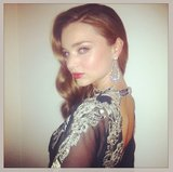 Miranda Kerr showed off her stunning earrings and Valentino embroidery before heading to Vanity Fair's afterparty. Source: Instagram user mirandakerrverified