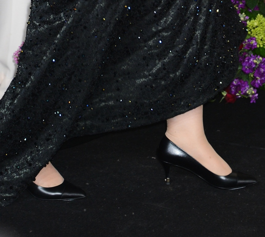 Upon entering the press room after the Oscars, Adele changed into a pai