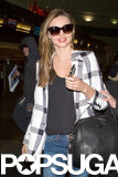 Miranda Kerr wore a plaid coat at the airport.