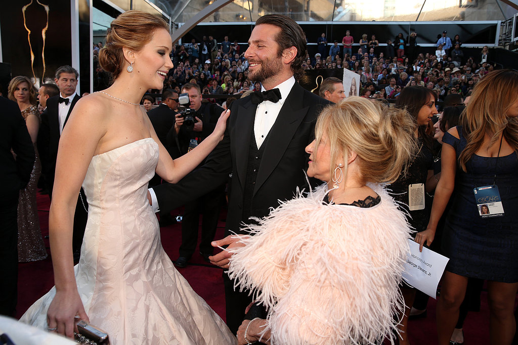 Jennifer Lawrence chatted with Bradley Cooper and his mom, Gloria, on the red carpet at the 2013 Oscars.