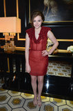 Chloë Moretz went textural in a red floral dress and nude strappy sandals at the H&M fashion show at Paris Fashion Week.