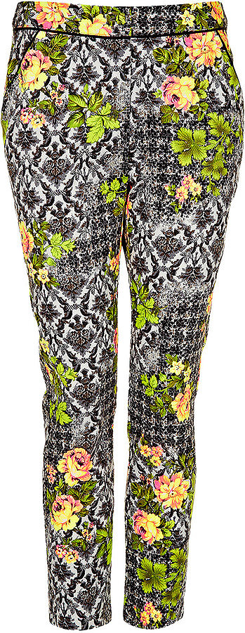 When worn with otherwise simple pieces, these Topshop Acid Leaf-Print Trousers ($76) can be perfect for the workplace.