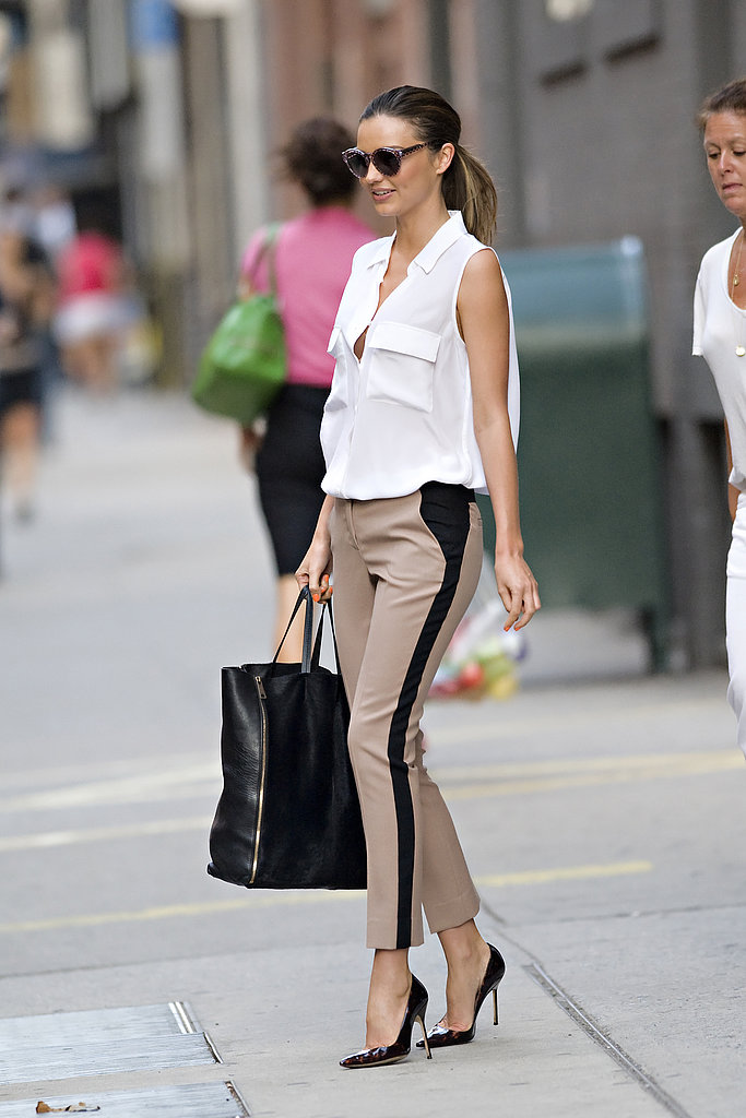 In a breezy sleeveless blouse and tuxedo-striped pants, Miranda's day wear is cooler than most; it all comes down to proportions and sophisticated details, like her posh pointed-toe Manolos.
