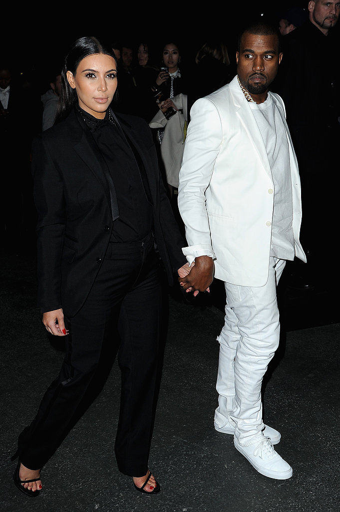 Kim Kardashian and Kanye West played opposites in head-to-toe black and white suiting, respectively, for their appearance at Givenchy.