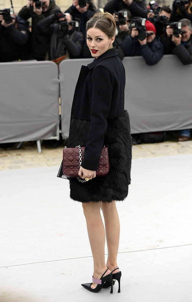 Olivia Palermo was the picture of Parisian chic arriving at the Dior show in a luxe black coat, sling-back pumps, Dior bag in hand, and the perfect rouge lip.