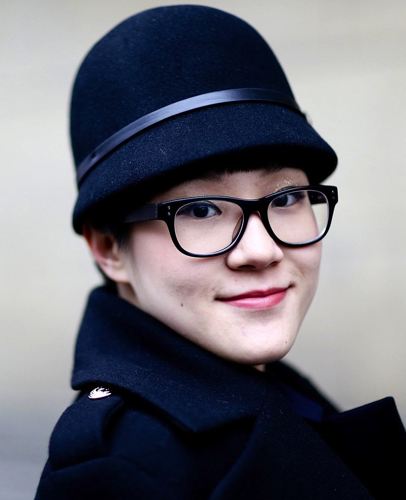 This Fashion Week attendee stayed warm in a chic military-inspired hat.