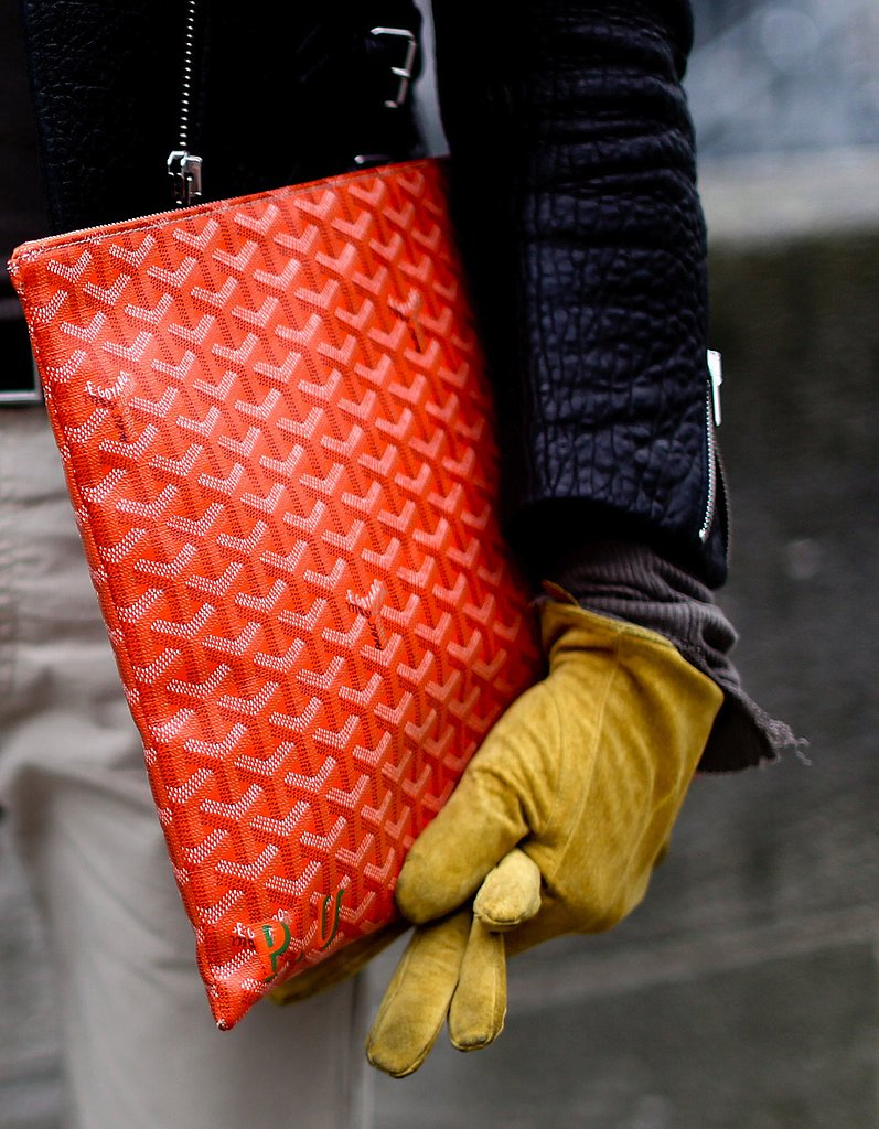 Nothing says pure luxury like a statement red Goyard portfolio.
