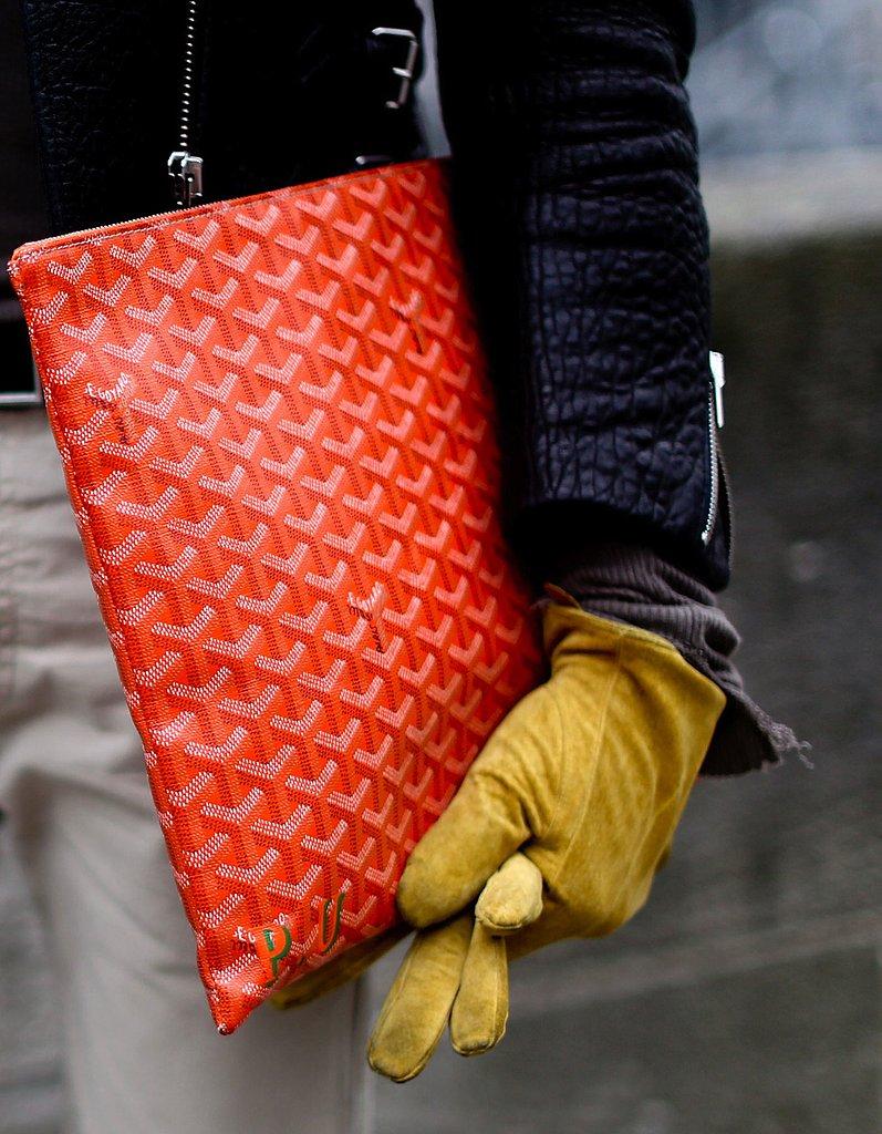 Nothing says pure luxury like a statement red Goyard portfolio.