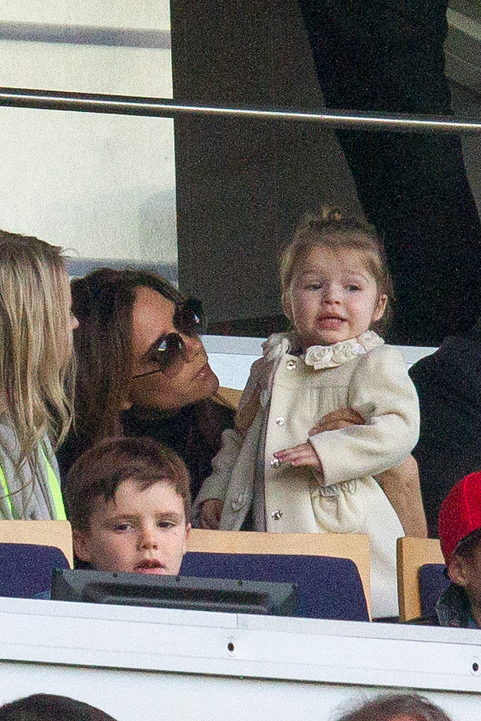 In March, Victoria Beckham held Harper while watching David Beckham play with Paris Saint-Germain.