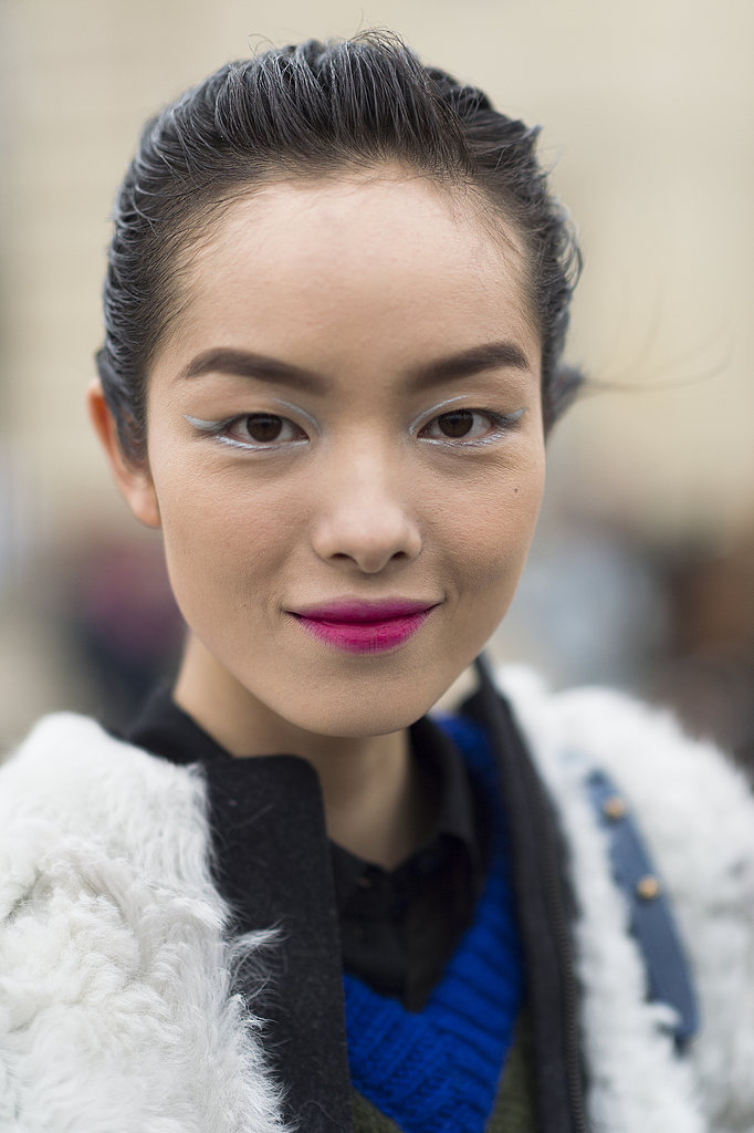 Model Fei Fei Sun smiled as she wore her fresh-from-the-runway palette of silvery cat eyes and raspberry-stained lips. Source: Le 21ème | Adam Katz Sinding