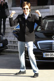 Paul McCartney flexed his muscles while walking into his daughter Stella McCartney's fashion show on Monday.