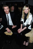 Kirsten Dunst and Garrett Hedlund sat front row at the Saint Laurent runway show at Paris Fashion Week on Monday.