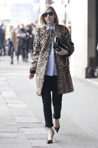 A leopard-print coat plays a posh complement to a basic button-up and pants.