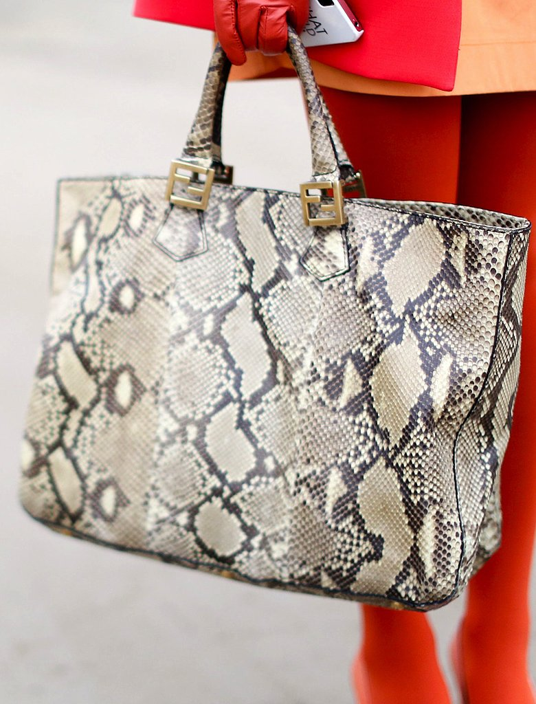A snakeskin tote simultaneously tempered and elevated this bright getup.