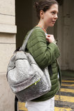 The backpack made its comeback, this time in a crackly metallic hue.