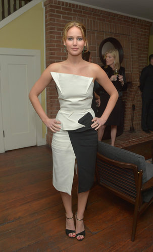 At a Vanity Fair event in NYC, Jennifer Lawrence went structural in a strapless black and white dress by Roland Mouret.