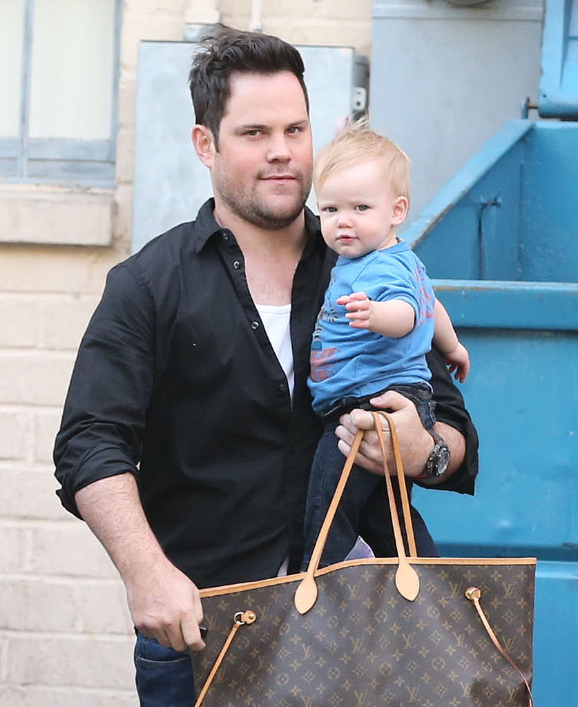 Mike Comrie carried Luca and his wife Hilary Duff's bag around LA.