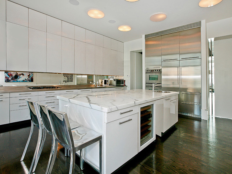 Sleek gourmet eat-in kitchen complete with a wine fridge. Source: Sotheby's
