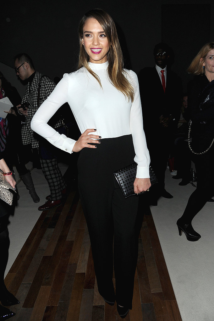Jessica Alba attended Valentino's A/W 2013 show at Paris Fashion Week looking sophisticated in a black-and-white pairing, finished with a black studded clutch.