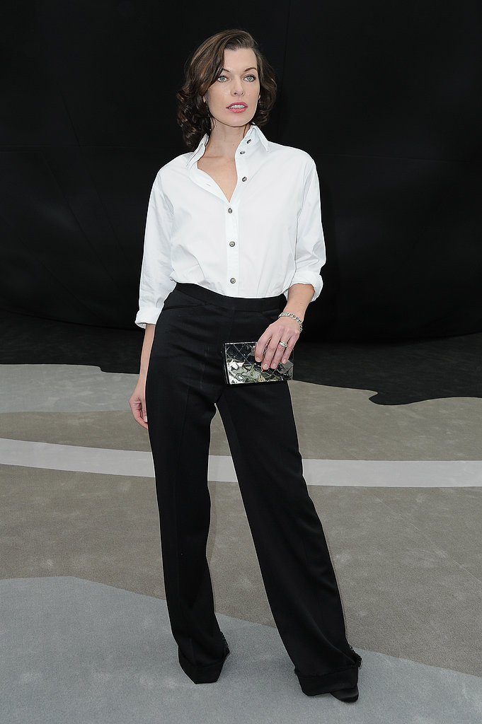Milla Jovovich also stuck to a black-and-white color scheme, but she opted to wear a classic white button-down with black wide-leg trousers and a metallic Chanel clutch.