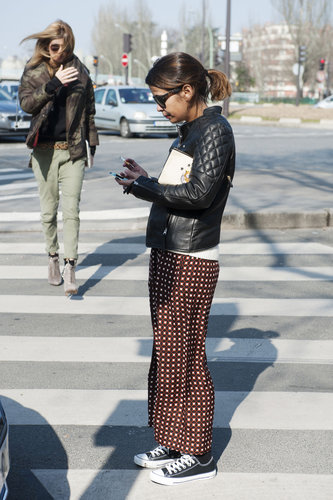 Pajama-style trousers were made street-ready with Converse and a leather jacket.