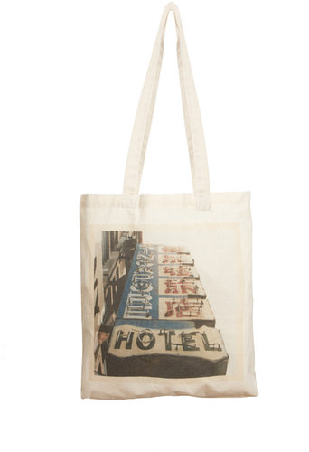 Borders & Frontiers Hotel Sign Shopper