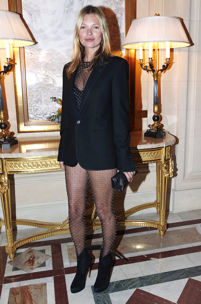 Kate Moss paired her studded bodysuit with a simple black leather clutch.