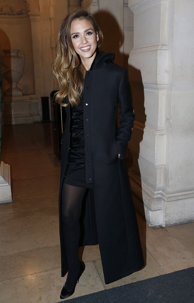 Jessica Alba smiled as she arrived at the CR Fashion Book launch party on Tuesday night.