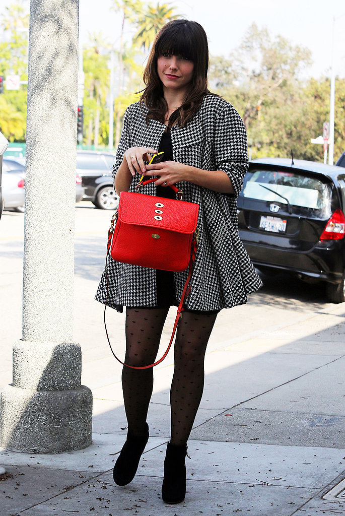 Sophia Bush oozed ladylike charm in a houndstooth swing coat, polka-dot tights, and her polished red Mulberry tote during a daytime outing in LA.