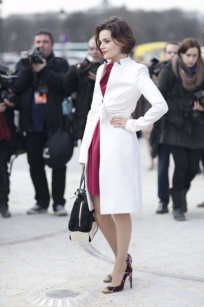 A sleek white coat got a femme twist with a bow-tied waist.